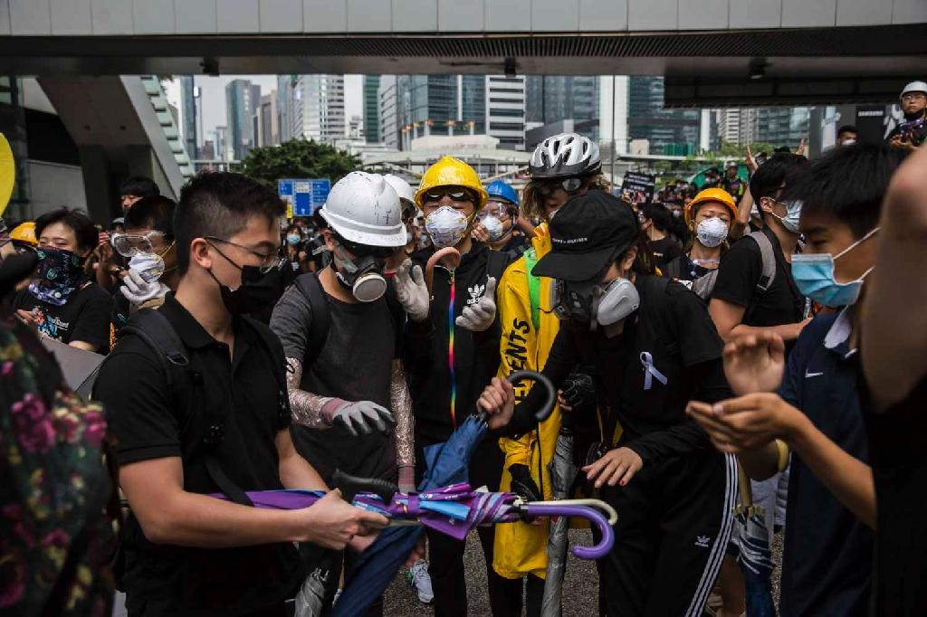 Protesters were in control of key roads in Hong Kong early Monday but later dispersed peacefully (AFP Photo/ISAAC LAWRENCE)