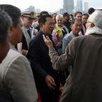 Cambodia PM defends ship docking despite virus diagnosis