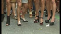 Men in high heels race along Spanish street