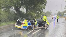 Police officer has lucky escape after patrol car wrecked while responding to 999 call
