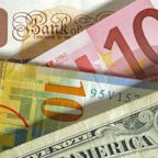 Dollar swings up on jobless claims