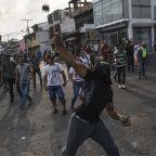 As Venezuela's Aid Burns, Maduro Claims Victory Over Guaido