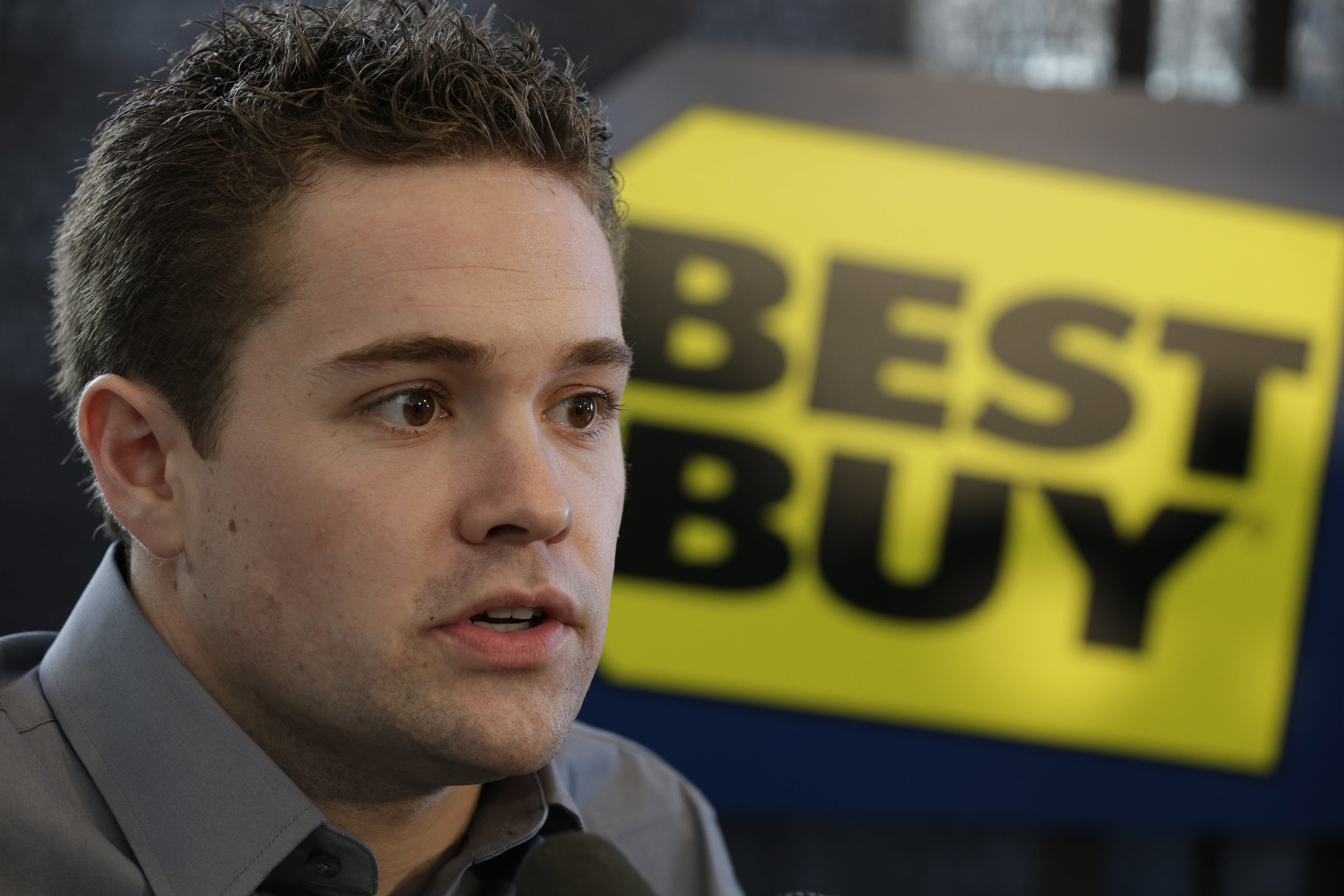 Driver Ricky Stenhouse Jr. talks to the media at a news conference during the NASCAR Sprint Cup Media Tour in Charlotte, N.C., Thursday, Jan. 24, 2013. (AP Photo/Chuck Burton)