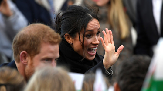 Prince Harry, Meghan Markle greeted by cheering fans in Wales