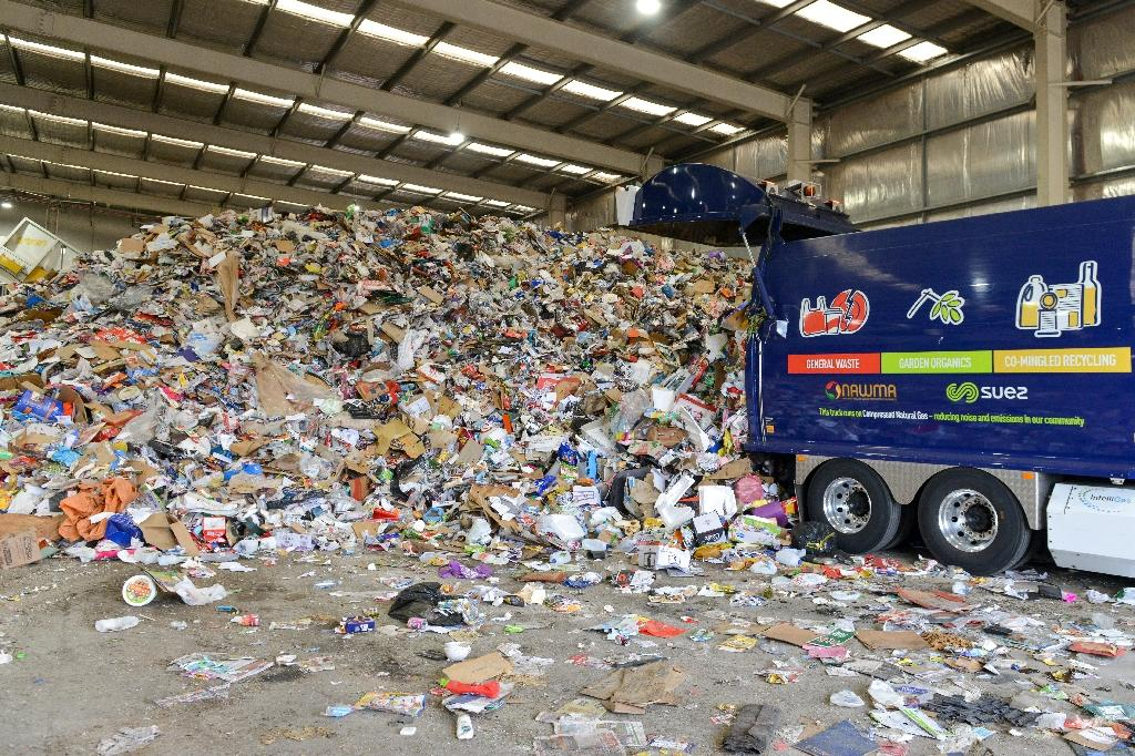 In Australia, Europe and the US, many of those collecting plastic and other recyclables were left scrambling to find new places to send it after China stopped importing plastic waste for recycling (AFP Photo/Brenton EDWARDS)