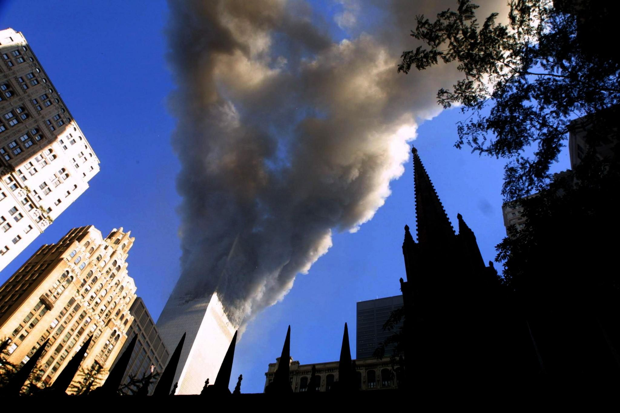 <p>Smoke spews from a tower of the World Trade Center Sept. 11, 2001, after two hijacked airplanes hit the twin towers in a terrorist attack on New York City. (Photo: Mario Tama/Getty Images) </p>