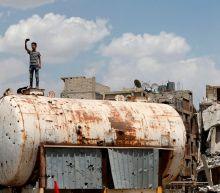 US denies involvement in Syria missile strike which kills 12