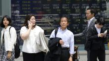 World shares mixed with no easing of China-US trade dispute