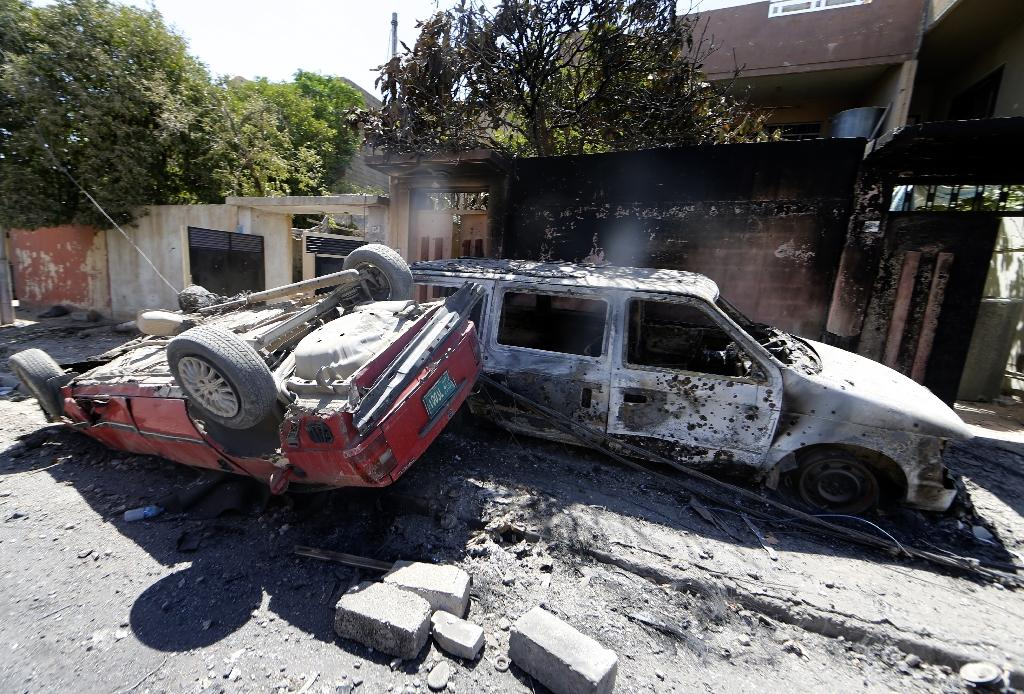 Iraqis are hunting for their family cars in Mosul areas retaken from the Islamic State group, but many -- like these in the western district of Zanjili on June 7, 2017 -- have been damaged in the fighting (AFP Photo/KARIM SAHIB)