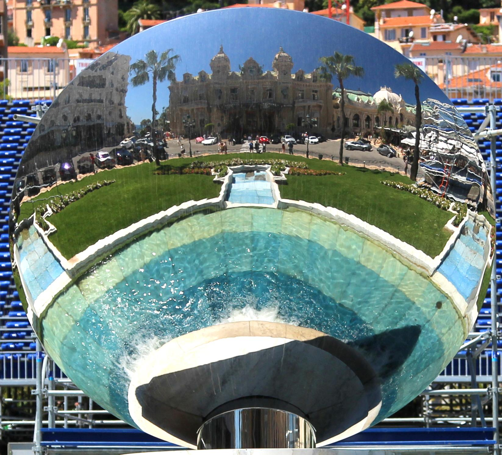 "This May 13, 2013 photo shows the sculpture ""Sky Mirror,"" which faces the Monte Carlo Casino in Monaco. The large circular mirror reflects the building and is one of a number of free things to see and do in Monaco. (AP Photo/Michelle Locke)"