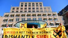 "Protesters chant ""Shell must fall"" at oil major's meeting"
