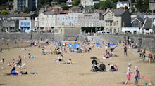 In pictures: Britons flock to beaches during coronavirus lockdown on hottest day of the year