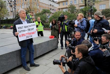 Russian opposition politician Sergei Mitrokhin takes part in a protest demanding authorities to allow opposition candidates to run in the upcoming local election and release people arrested for participation in opposition rallies, in Moscow