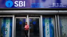 SBI profit lifted by stake sale in boost to shares