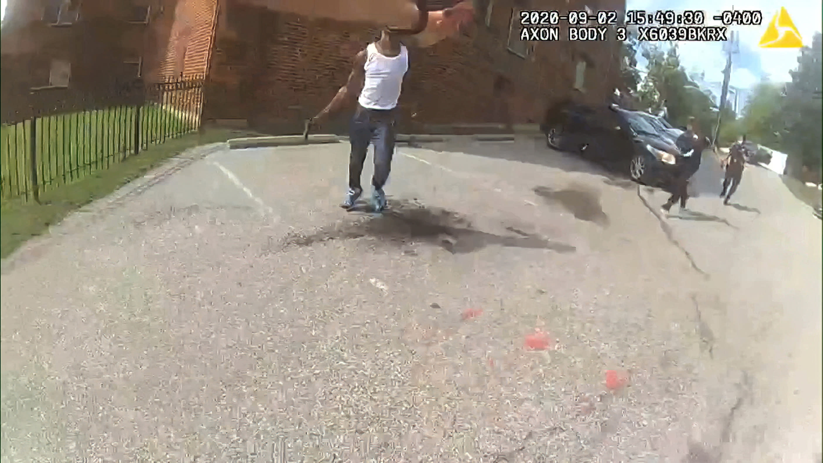 This image from video released by the Metropolitan Police Department, shows body cam video during a foot pursuit with Deon Kay, center, in Washington, on Wednesday afternoon, Sept. 2, 2020. Police in the nation's capital released body camera footage from the officer who fatally shot the Black 18-year-old in the chest. (Metropolitan Police Department via AP)