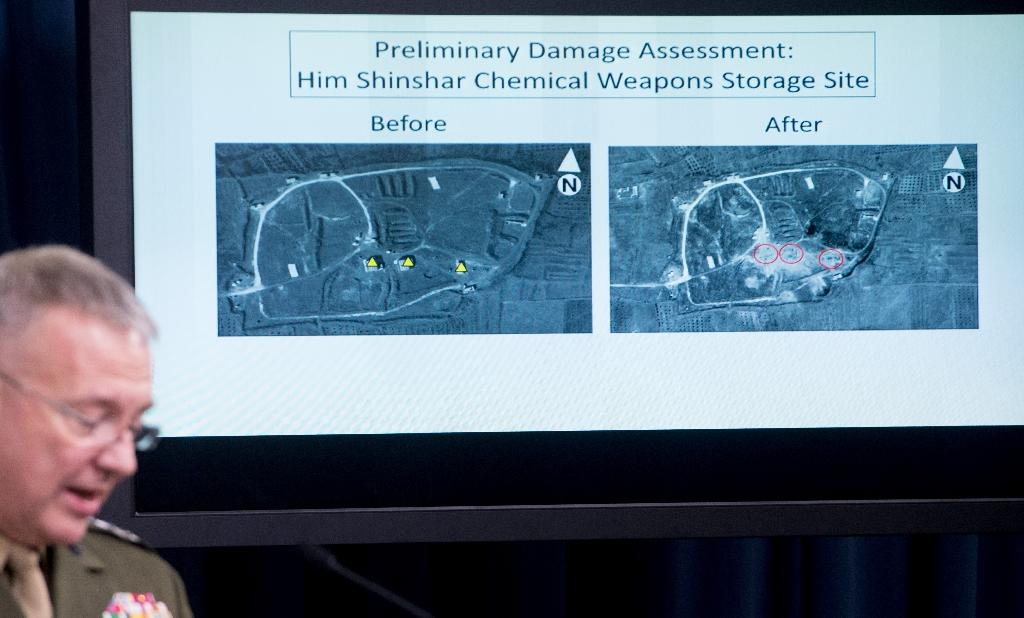 US Marine Lt. Gen. Kenneth F. McKenzie Jr. shows a damage assesment image of the Him Shinshar Chemical Weapons Storage site April 14 2018 after the US, France and Britain launched airstrikes in Syria in response to a chemical weapons attack