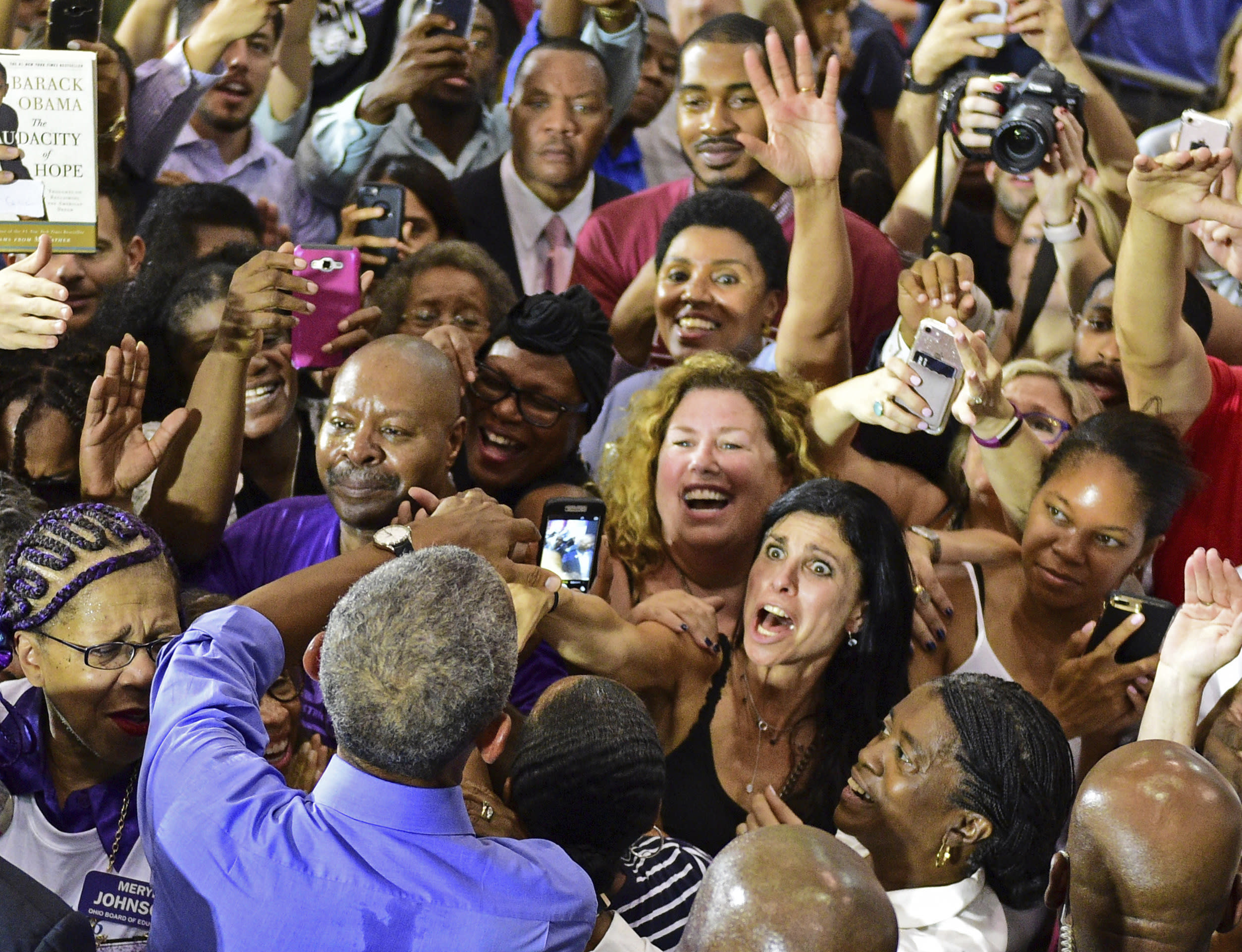 Former President Barack Obama shakes hands with members of the audience as he campaigns in support of Ohio gubernatorial candidate Richard Cordray, Thursday, Sept. 13, 2018, in Cleveland. (AP Photo/David Dermer)