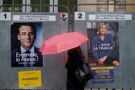 Macron y Le Pen intercambian ataques en ceremonias por Día del Trabajador