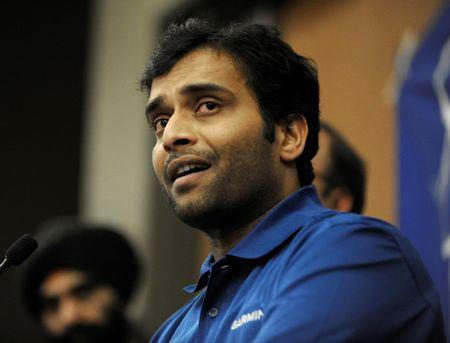 Alok Madasani, who was wounded in a shooting that killed Indian engineer Srinivas Kuchibhotla, attends a vigil at a conference center in Olathe, Kansas