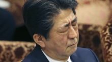 Japan PM's approval ratings dive over land sale scandal
