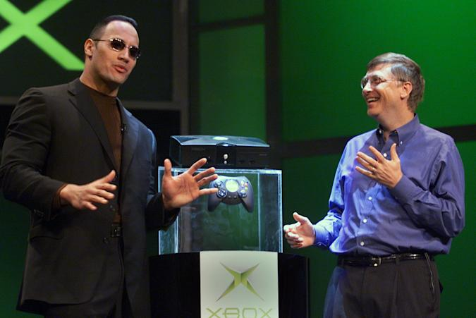 The Rock and Bill Gates on stage in the '90s.