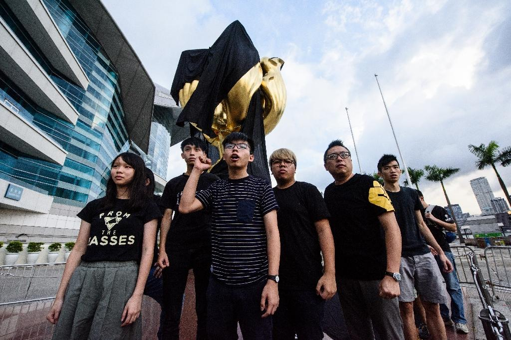 Pro-democracy campaigners fear Hong Kong's freedoms are being lost to Beijing (AFP Photo/Anthony WALLACE)