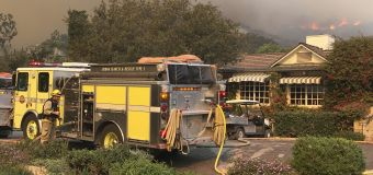 Flames approach wealthy California enclave