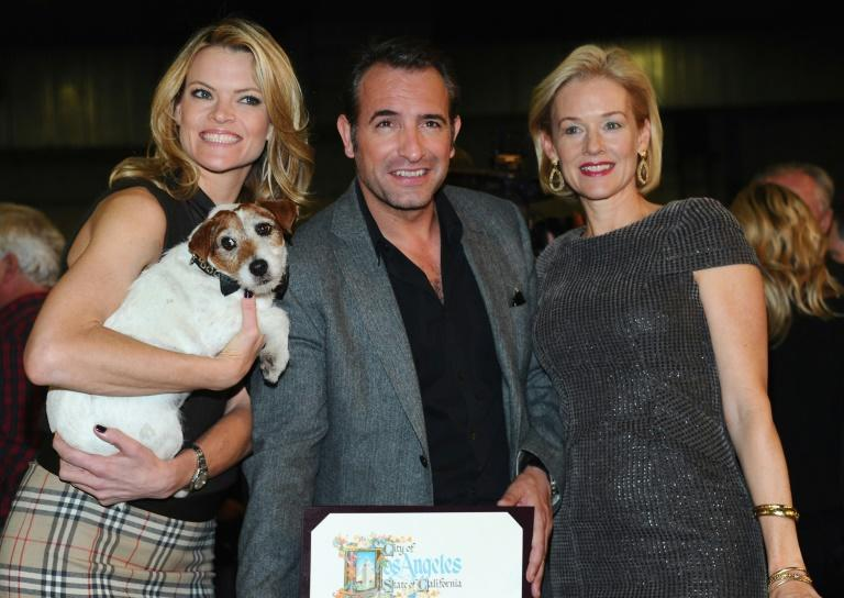 Uggie with 'The Artist' co-stars Missi Pyle, Jean Dujardin and Penelope Ann Miller back in 2012 (AFP Photo/Alberto E. Rodriguez)