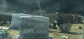 Uniformed man seen kneeling by Beau Biden's grave