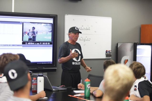 Former NFL coach Mike Shanahan talks to high school prospects during the camp. (San Francisco 49ers coach Kyle Shanahan teaches high school prospects the finer points of a dropback. (Photo Credit: Twitter/@qb_collective)