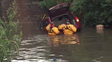 Car Trapped on Flooded Road in Watertown, Wisconsin