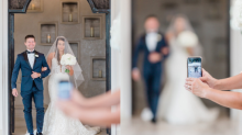 Wedding photographer calls out guest for ruining 'once in a lifetime moment' by taking out cell phone