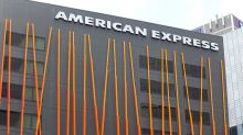 American Express Earnings Top; But Dow Stock Falls
