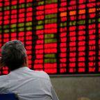 Global stocks wilt as Fed shift sparks stampede into bonds