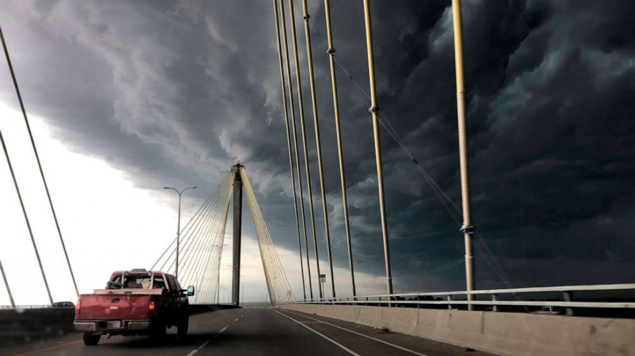 Heat wave spreads east, storms linger in Midwest