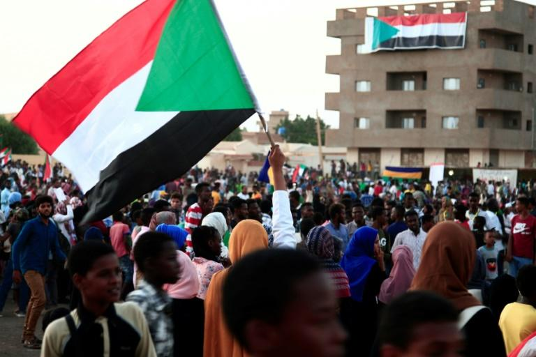 Thousands of Sudanese rallied late last month in several cities, urging the new authorities to dissolve the former ruling party (AFP Photo/EBRAHIM HAMID)