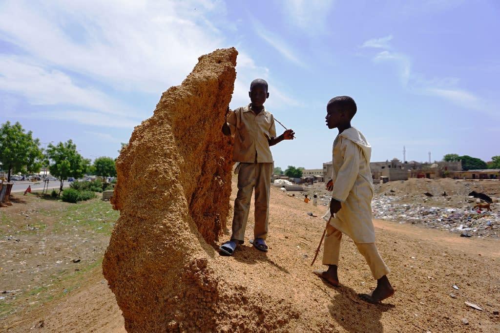 The walls no longer mark the city limits (AFP Photo/AMINU ABUBAKAR)