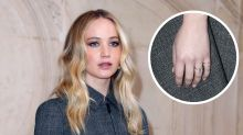 Jennifer Lawrence flashes her new engagement ring at Dior fashion show