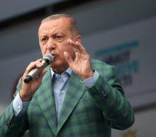 Turkey's Erdogan, main rival stage final election rallies