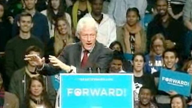 Clinton hits Romney for
