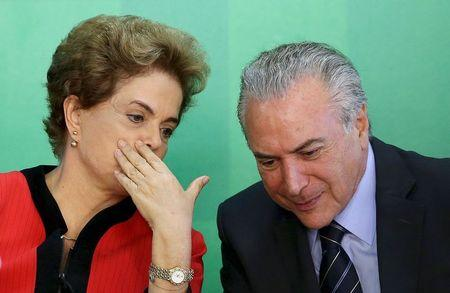 Brazil's President Dilma Rousseff (L) talks to Vice President Michel Temer at the Planalto Palace in Brasilia, Brazil, in this March 2, 2016 file photo. REUTERS/Adriano Machado/Files