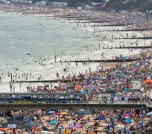 Coronavirus: Packed beaches pictured across England as infections rise and lockdown easing postponed