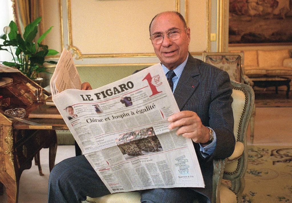 Dassault with the newspaper he owned (AFP Photo/JOEL ROBINE)