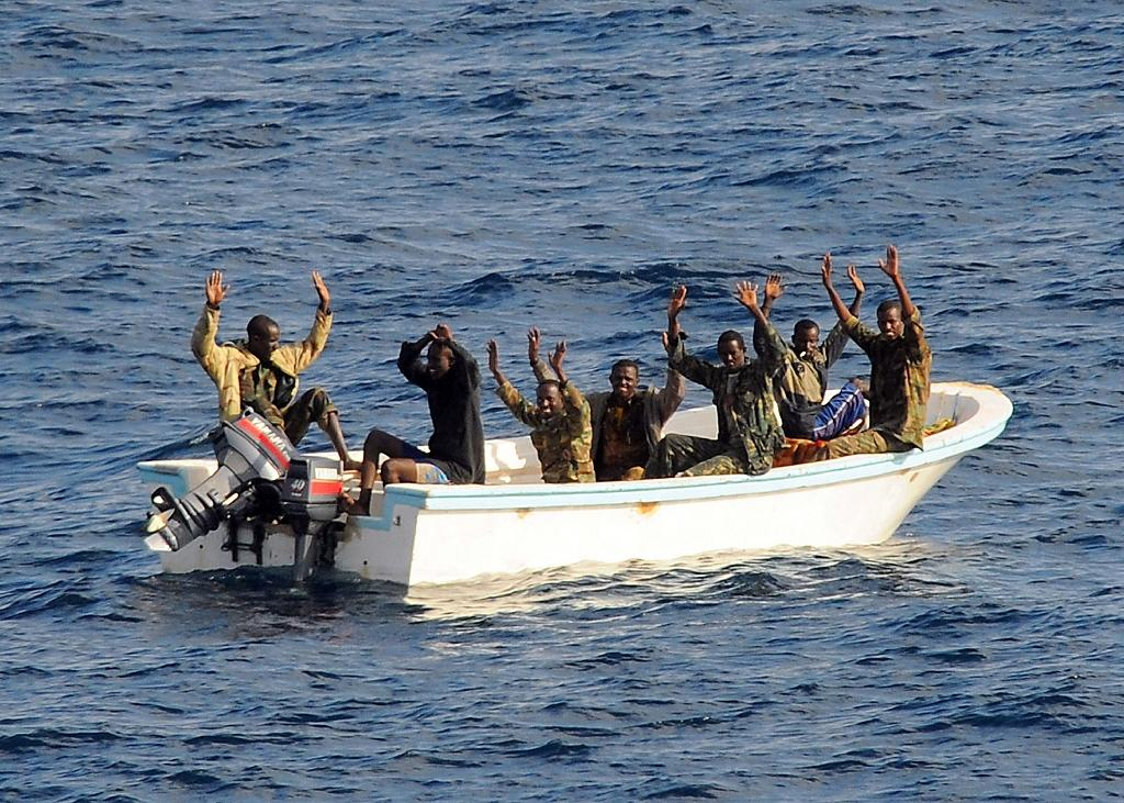Suspected pirates keep their hands in the air as directed by a patrol from the guided-missile cruiser USS Vella Gulf, in the Gulf of Aden (AFP Photo/Jason R. Zalasky)