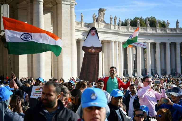Giant portraits of the new saints were hung from Saint Peter's Basilica for the canonisation ceremony which attracted tens of thousands of pilgrims (AFP Photo/Alberto PIZZOLI)
