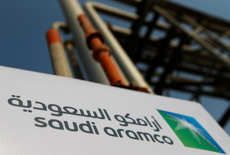 FILE PHOTO: A Saudi Aramco sign at the company's Abqaiq oil plant
