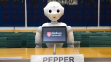 'She's better than the Maybot': PM upstaged by actual robot