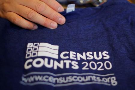 T-shirts are displayed at a community activists and local government leaders event to mark the one-year-out launch of the 2020 Census efforts in Boston