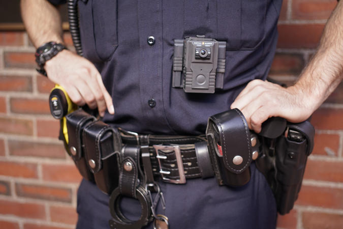 PORTLAND, ME - OCTOBER 4: Patrol officer Nevin Rand displays a body camera that all patrol officers on the Portland Police Department will now wear while on patrol. Photographed on Friday, October 4, 2019 at the Portland Police Department. (Staff photo by Gregory Rec/Portland Press Herald via Getty Images)