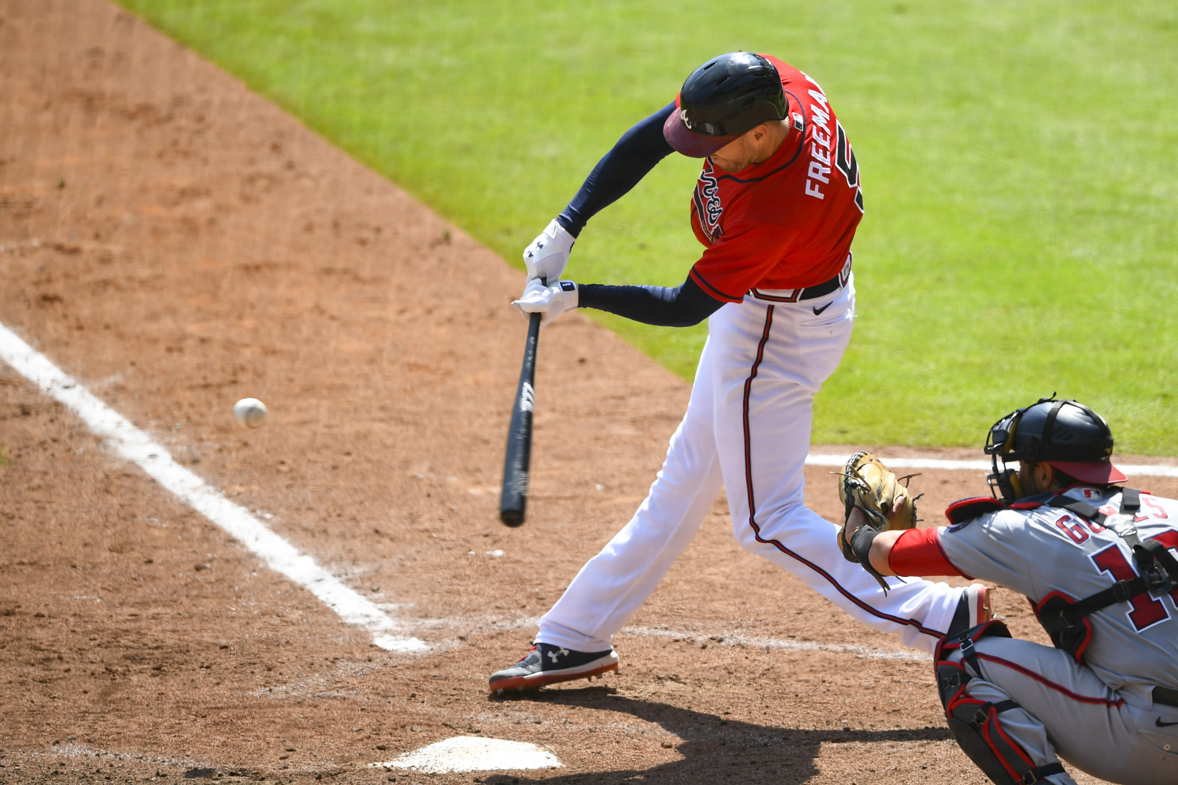 Atlanta Braves' Freddie Freeman connects for a grand slam over left center field during the sixth inning of a baseball game against the Washington Nationals, Sunday, Sept. 6, 2020, in Atlanta. (AP Photo/John Amis)